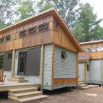 Compact Modular Pre Fab Cottage Made Local Materials Sits Amongst