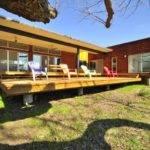 Custom Prefab Modular House Patinated Metal Facade Austin Texas