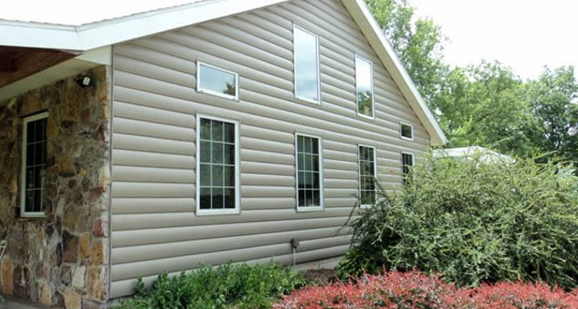 Fake Log Siding Cool Tone Gray Complements Home Stone