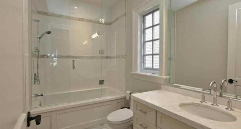 Glass Shower Doors Over Tub White Bathroom