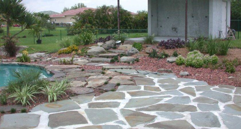 Here Stone Patio Design Enclosing Swimming Pool Area