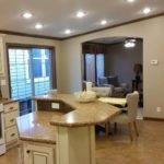 Included Home White Kitchen Cabinets Fireplace Above