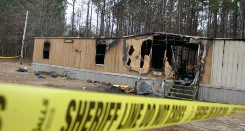 Ray Van Dusen Monroe Journal Fire Tape Surrounds Mobile Home